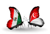 Two butterflies with flags of Mexico and Singapore on wings — ストック写真