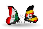 Two butterflies with flags of Mexico and Uganda on wings — Stock Photo