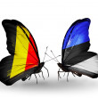 Stock Photo: Butterflies with flags Belgium and Estonion wings