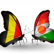 Stock Photo: Butterflies with Belgium and Niger flags on wings