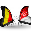 Stock Photo: Butterflies with Belgium and Singapore flags on wings