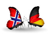 Butterflies with Norway and Germany flags on wings — Stock Photo