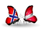 Butterflies with Norway and Latvia flags on wings — Stock Photo