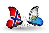 Schmetterlinge mit norwegen und san marino flaggen am flügel — Stockfoto