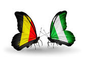 Butterflies with flags Belgium and Nigeria on wings — Stock Photo