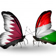 Butterflies with Qatar and Hungary flags on wings — Stock Photo #40349439