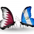 Butterflies with Qatar and Guatemalflags on wings — Stock Photo #40349557
