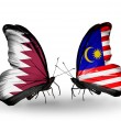 Butterflies with Qatar and Malaysiflags on wings — Stock Photo #40349959