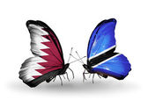 Butterflies with Qatar and Botswana flags on wings — Stock Photo