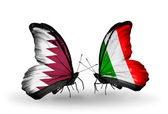 Butterflies with Qatar and Italy flags on wings — Стоковое фото
