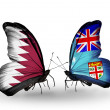 Stock Photo: Butterflies with Qatar and Fiji flags on wings