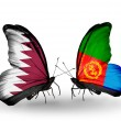 Stock Photo: Butterflies with Qatar and Eritreflags on wings