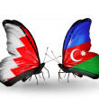 Foto Stock: Butterflies with Bahrain and Azerbaijflags on wings
