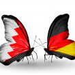 Stock Photo: Butterflies with Bahrain and Germany flags on wings