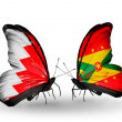 Stock Photo: Butterflies with Bahrain and Grenadflags on wings