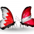 Stock Photo: Butterflies with Bahrain and Latviflags on wings
