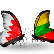 Stock Photo: Butterflies with Bahrain and Lithuaniflags on wings