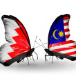 Foto Stock: Butterflies with Bahrain and Malaysiflags on wings