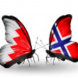 Stock Photo: Butterflies with Bahrain and Norway flags on wings