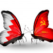 Stock Photo: Butterflies with Bahrain and Soviet Union flags on wings