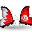 Stock Photo: Butterflies with Bahrain and Tunisiflags on wings