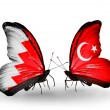 Foto Stock: Butterflies with Bahrain and Turkey flags on wings