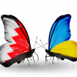 Stock Photo: Butterflies with Bahrain and Ukraine flags on wings