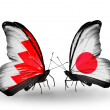 Stock Photo: Butterflies with Bahrain and Japflags on wings