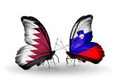 Butterflies with Qatar and Slovenia flags on wings — Stock Photo
