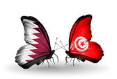 Butterflies with Qatar and Tunisia flags on wings — Stock Photo