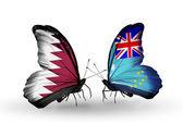 Papillons avec des drapeaux de qatar et tuvalu sur ailes — Photo