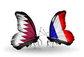 Butterflies with Qatar and France flags on wings — Stock Photo