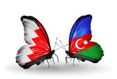Butterflies with Bahrain and Azerbaijan flags on wings — Stock Photo