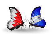 Butterflies with Bahrain and Honduras flags on wings — Stock Photo