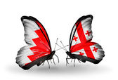 Butterflies with Bahrain and Georgia flags on wings — Stock Photo