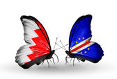Butterflies with Bahrain and Cape Verde flags on wings — Stock Photo