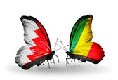 Butterflies with Bahrain and Kongo flags on wings — Stock Photo