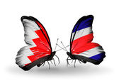 Butterflies with Bahrain and Costa Rica flags on wings — Stock Photo