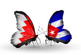 Butterflies with Bahrain and Cuba flags on wings — Stock Photo