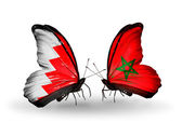Butterflies with Bahrain and Morocco flags on wings — Stock Photo