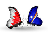 Butterflies with Bahrain and Marshall islands flags on wings — Stock Photo