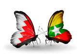Butterflies with Bahrain and Myanmar flags on wings — Stock Photo