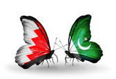 Butterflies with Bahrain and Pakistan flags on wings — Stock Photo