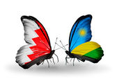 Butterflies with Bahrain and Rwanda flags on wings — Stock Photo