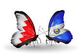 Butterflies with Bahrain and Salvador flags on wings — Stock Photo