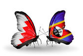 Butterflies with Bahrain and Swaziland flags on wings — Stock Photo