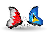 Butterflies with Bahrain and Saint Lucia flags on wings — Stock Photo