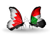 Butterflies with Bahrain and Sudan flags on wings — Stock Photo