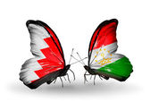 Butterflies with Bahrain and Tajikistan flags on wings — Stock Photo