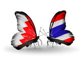 Butterflies with Bahrain and Thailand flags on wings — Stock Photo